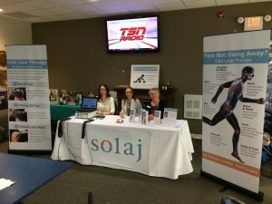 Solaj display, myself and a few Solaj team members, set up at the Peace Arch Curling Club Bonspiel
